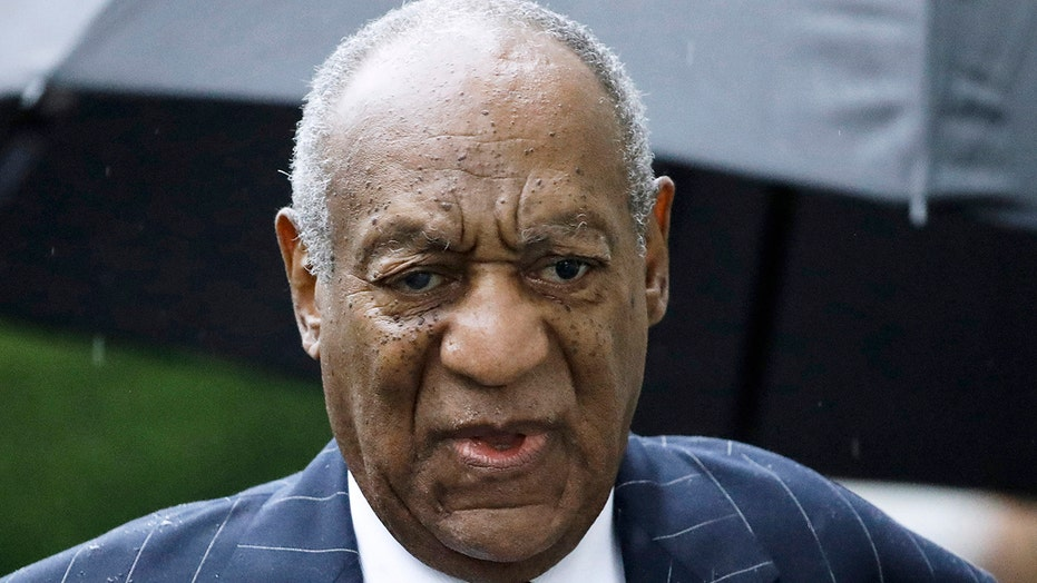Bill Cosby's team posts photo to 'reassure his family and supporters' he's 'doing OK' after mugshot goes viral