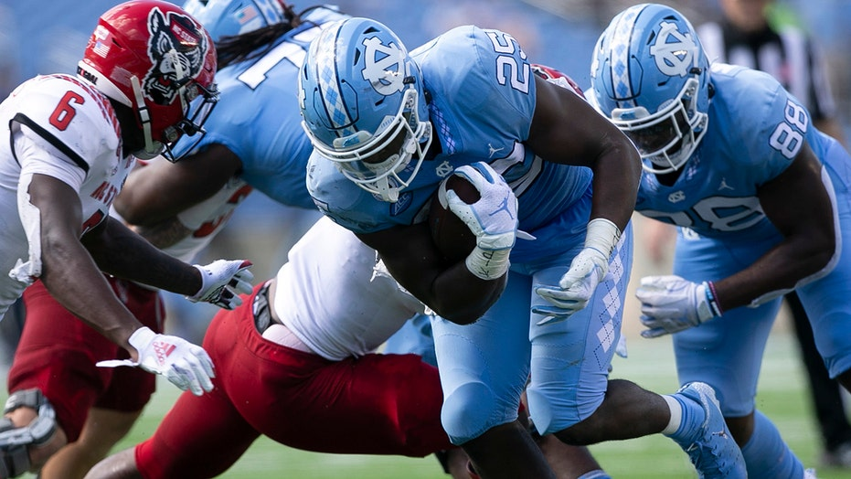 Williams, Carter lead No. 14 UNC past No. 23 NC State 48-21