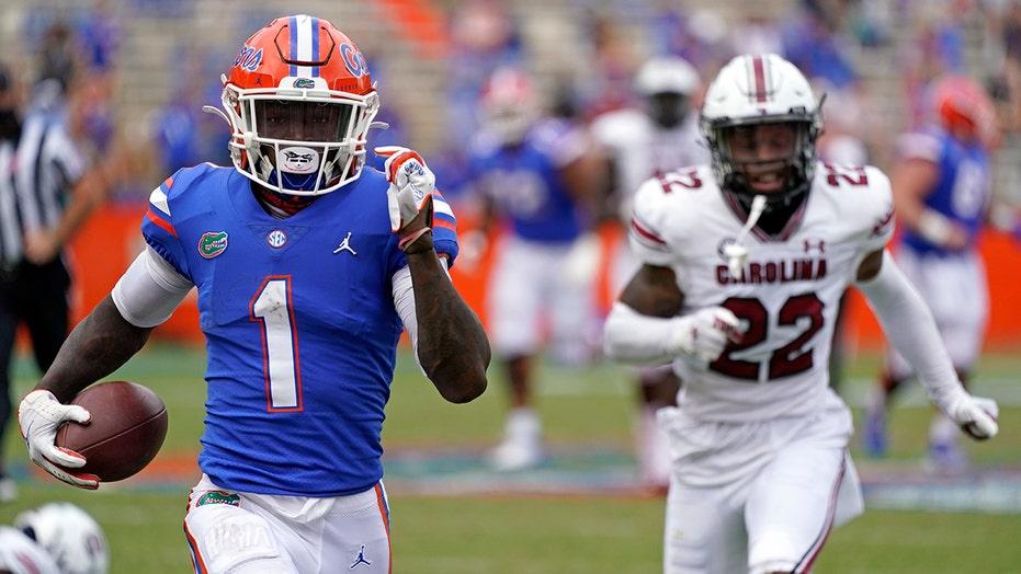 Florida's Kadarius Toney breaks through several South Carolina defenders for touchdown