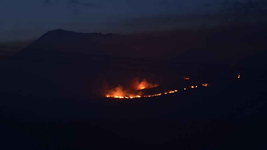 Firefighters battle blaze on Mount Kilimanjaro seen from miles away