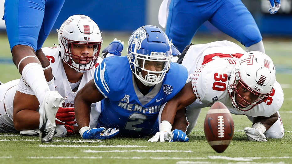 White throws four TDs, Memphis rallies past Temple