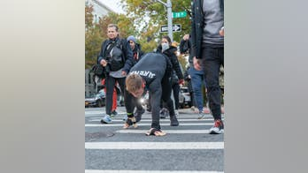 'Bear crawl' for 26 miles: Fitness entrepreneur raised big funds for veterans at New York City Marathon