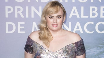 Rebel Wilson shows off weight loss in snowy snap after hitting her goal