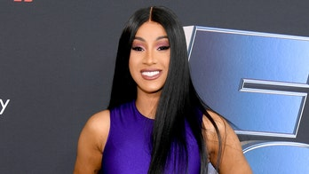 Cardi B smokes multiple cigarettes at once while watching 'these states turn red'
