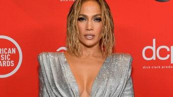 Jennifer Lopez stuns in low-cut green swimsuit on recent island getaway