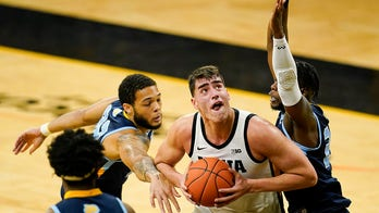 Nearly perfect Garza scores 41, No. 5 Iowa routs Southern