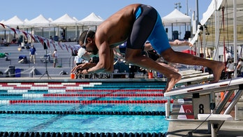 With COVID-19 surging, swimmers return to racing in the US