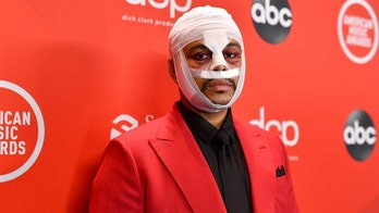 The Weeknd puzzles fans by appearing at the 2020 AMAs with bloodied, bandaged face