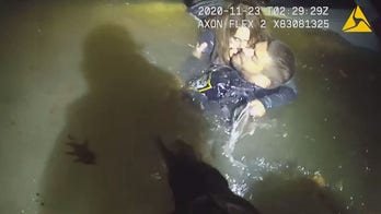 Ohio police rescue woman trapped in sinking minivan after crashing in river, video shows