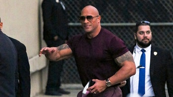 Dwayne Johnson can't fit into Porsche Taycan electric sport sedan during shoot for film 'Red Notice'