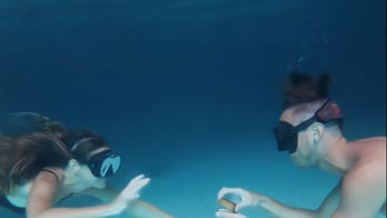Man surprises girlfriend with romantic underwater proposal on Jamaican seafloor