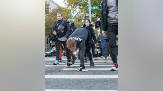 'Bear crawl' for 26 miles: Fitness entrepreneur raised big funds for veterans at New York City Marathon