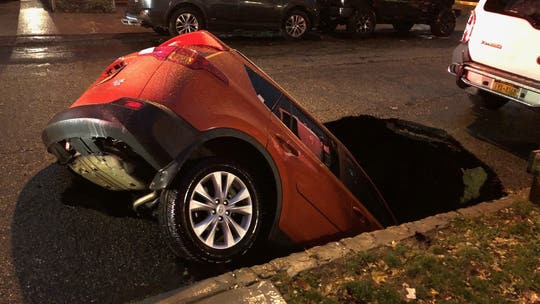 New York City sinkhole swallows SUV