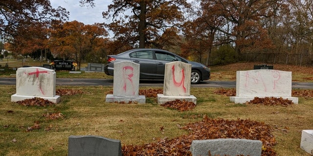 Jewish headstones were found desecrated Monday with pro-Trump slogans inside a Grand Rapids, Mich., Jewish cemetery.