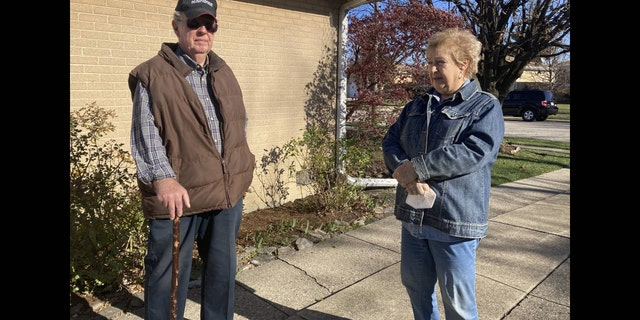 <br> Dan and Barbara Donovan of Niles say they were targeted by intruders when a man claiming to be a ComEd employee came to their home, Tuesday, Nov. 17, 2020 in Niles, Ill. Donovan, an 81-year-old former Marine from suburban Chicago used his grandfather's antique Irish walking stick to chase off three burglars and deliver one a thump in the head for his trouble.(Jennifer Johnson/Chicago Tribune via AP)