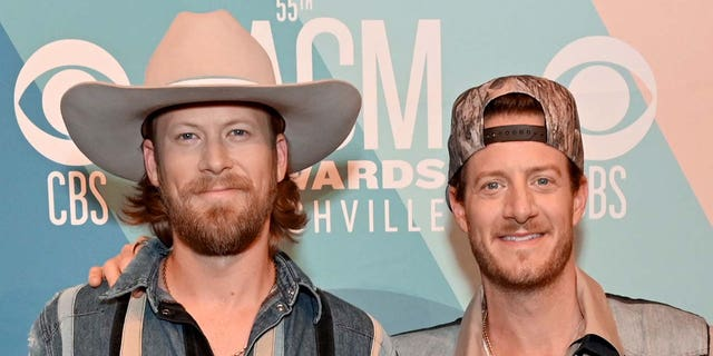 (L-R) Brian Kelley and Tyler Hubbard of Florida Georgia Line confirm the band isn't breaking up.
