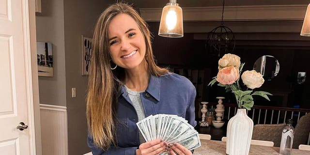 Alyssa Greene poses with the tip money on her Instagram before giving it to the staff at Va Bene.