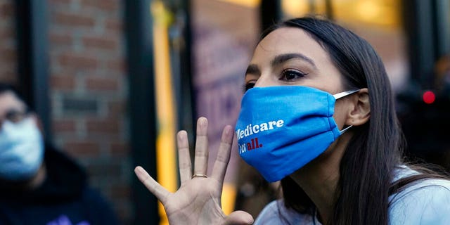 U.S. Rep. Alexandria Ocasio-Cortez, D-N.Y., speaks to members of her staff and volunteers who helped get out the vote and with her campaign, Tuesday, Nov. 3, 2020, outside her office in the Bronx borough of New York. (AP Photo/Kathy Willens)
