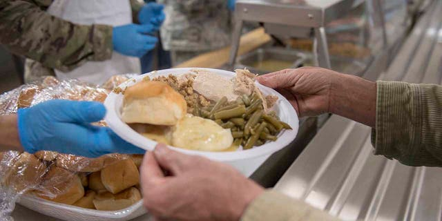 Airmen, soldiers, veterans and their families gather for the Chaplains Thanksgiving Dinner Nov. 15, 2018 at Gowen Field, Boise, Idaho. The annual event is held to provide a free holiday meal and build esprit de corps amongst those who have served and are currently serving. (U.S. Air National Guard photo by Master Sgt. Joshua C. Allmaras)