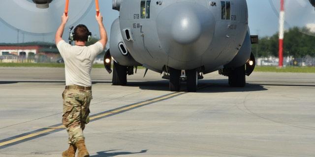 U.S. Air Force Tech. Sgt. Deklan Woolsey, 165th Airlift Wing crew chief, marshals a C-130H3 at Savannah Air National Guard Base, Savannah, Ga. (U.S. Air Force photo by Senior Airman Renee Crugnale)