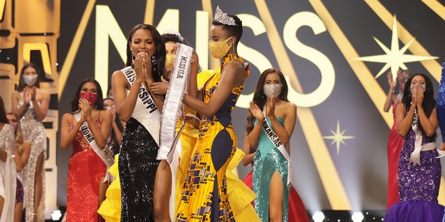 Asya Branch, Miss Mississippi USA 2020, is announced Miss USA 2020 winner, on stage with Cheslie Kryst, Miss USA 2019, and Zozi Tunzi, Miss Universe 2019.