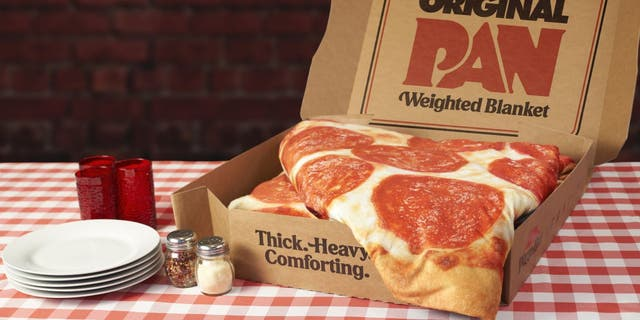 A $150 Pizza Hut blanket sold out in just hours on Wednesday.(Pizza Hut)