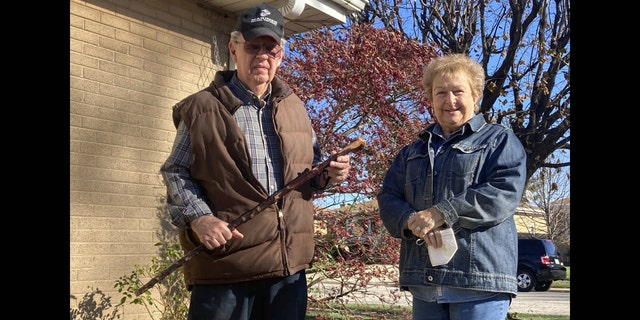 <br> Dan Donovan, joined by his wife, Barbara, holds the antique shillelagh he used to chase burglars from the couple's Niles home even hitting one of the men in the back of the head, Tuesday, Nov. 17, 2020 in Niles, Ill. Donovan, an 81-year-old former Marine from suburban Chicago used his grandfather's antique Irish walking stick to chase off three burglars and deliver one a thump in the head for his trouble.(Jennifer Johnson/Chicago Tribune via AP)