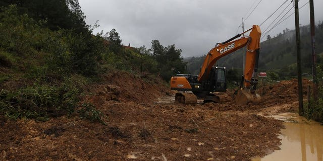 A backhoe clears a road blocked by debris brought on by a landslide in the aftermath of Hurricane Eta, in Purulha, northern Guatemala Nov. 6. As the remnants of Eta moved back over Caribbean waters, governments in Central America worked to tally the displaced and dead, and recover bodies from landslides and flooding that claimed dozens of lives from Guatemala to Panama. (AP Photo/Moises Castillo)