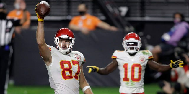 Kansas City Chiefs tight end Travis Kelce (87) celebrates after scoring a touchdown against the Las Vegas Raiders during the second half of an NFL football game, Sunday, Nov. 22, 2020, in Las Vegas. (AP Photo/Isaac Brekken)