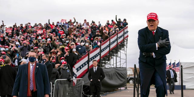President Donald Trump arrives Oakland County International Airport, Sunday, Nov. 1, 2020, in Waterford Township, Mich. (AP Photo/Evan Vucci)