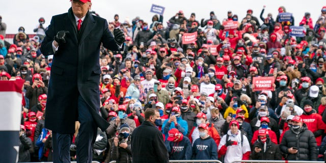 President Trump dances as he walks off stage after speaking during a campaign rally at Michigan Sports Stars Park, Sunday, Nov. 1, 2020, in Washington, Mich. (AP Photo/Evan Vucci)