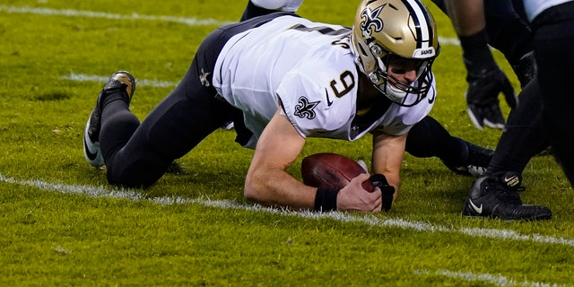New Orleans Saints quarterback Drew Brees (9) recovers a fumble in the first half of an NFL football game against the Chicago Bears in Chicago, Sunday, Nov. 1, 2020. (AP Photo/Nam Y. Huh)
