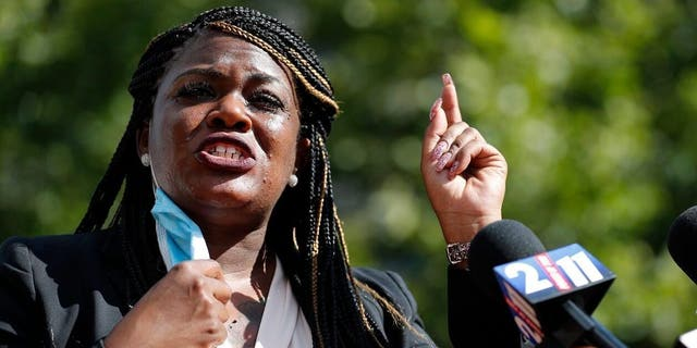 FILE - In this Aug. 5, 2020, file photo, then-activist Cori Bush speaks during a news conference Wednesday, Aug. 5, 2020, in St. Louis. Bush was elected to Congress in November and is a member of the progressive Squad. (AP Photo/Jeff Roberson, File)