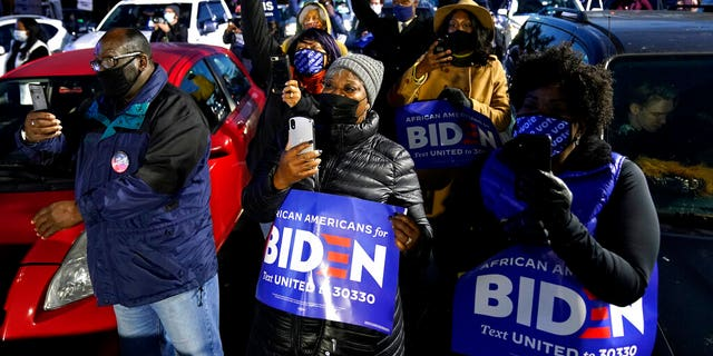 Supporter listen as Democratic presidential candidate former Vice President Joe Biden speaks at a drive-in campaign rally at Lexington Technology Park, Monday, Nov. 2, 2020, in Pittsburgh. (AP Photo/Andrew Harnik)
