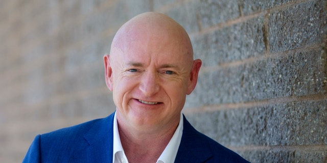 Mark Kelly poses for a photo outside of the Udall Park Main Recreation Center, Tuesday, Sept. 29, 2020 - file photo. (Mamta Popat/Arizona Daily Star via AP)