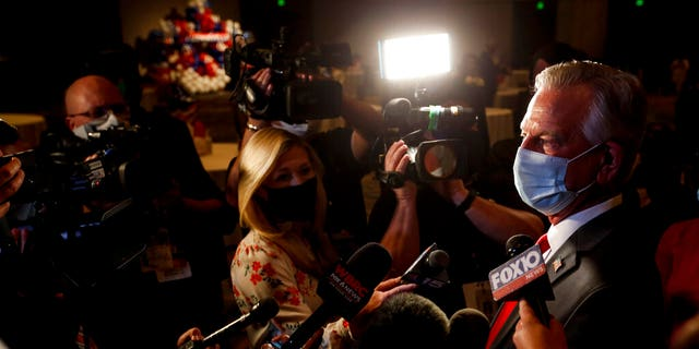 Republican U.S. Senate candidate Tommy Tuberville talks with media as he arrives for the watch party at the Renaissance Hotel on Tuesday, Nov. 3, 2020, in Montgomery, Ala. (Associated Press)