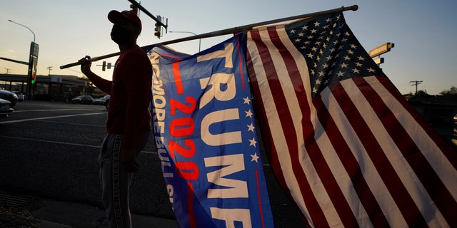 Trump supporters gather near the Salt Lake County Government Center Tuesday, Nov. 3, 2020, in Salt Lake City. (AP Photo/Rick Bowmer)