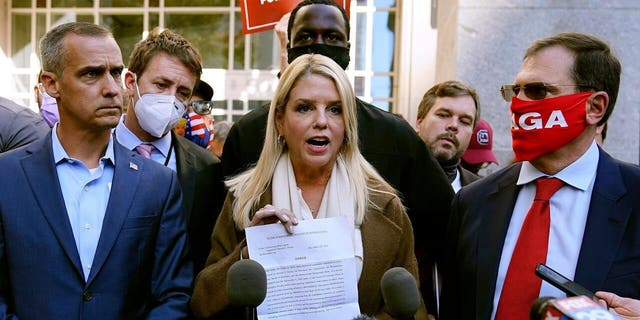 Former Florida Attorney General Pam Bondi displays a court order granting President Trump's campaign more access to vote counting operations at the Pennsylvania Convention Center, Thursday, Nov. 5, 2020, in Philadelphia. (AP Photo/Matt Slocum)