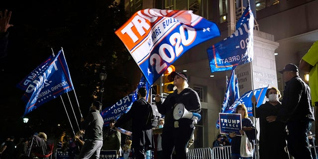 Supporters of President Trump stand outside the Pennsylvania Convention Center where votes are being counted, Thursday, Nov. 5, 2020, in Philadelphia, following Tuesday's election. (AP Photo/Matt Slocum)