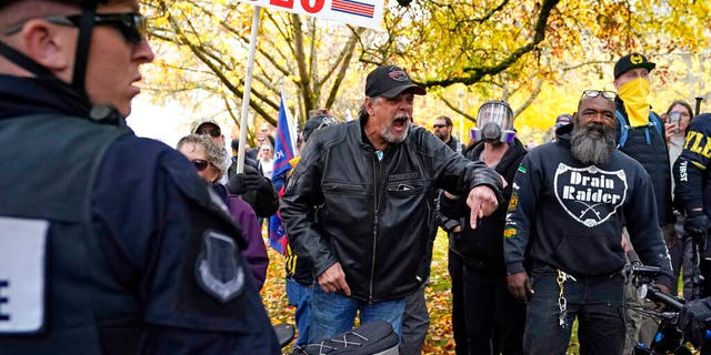 Supporters of President Trump yell at counter-protesters at the Oregon State Capitol building Nov 7, in Salem, Ore., after Democrat Joe Biden defeated Trump to become 46th president of the United States. (AP Photo/Marcio Jose Sanchez)