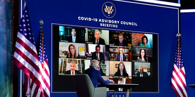 President-elect Joe Biden listens during a meeting with Biden's COVID-19 advisory council, Monday, Nov. 9, 2020, at The Queen theater in Wilmington, Del. (AP Photo/Carolyn Kaster)