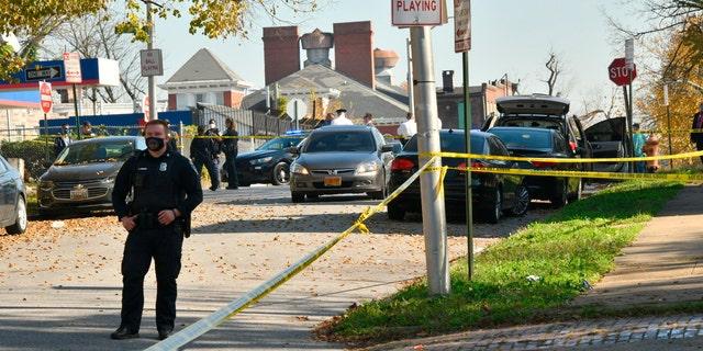 Baltimore police investigate the scene of a shooting in the city's Rosemont neighborhood Monday morning, Nov. 9, 2020. (Amy Davis/The Baltimore Sun via AP)