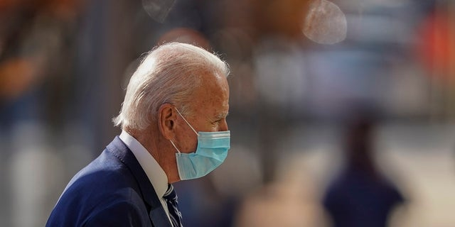President-elect Joe Biden arrives at The Queen theater, Tuesday, Nov. 10, 2020, in Wilmington, Del. (AP Photo/Carolyn Kaster)