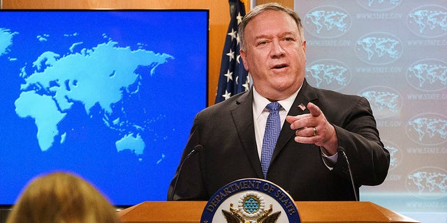 Then-Secretary of State Mike Pompeo gestures toward a reporter while speaking about the counting of votes in the U.S. election during a briefing to the media, Tuesday, Nov. 10, 2020, at the State Department in Washington. (AP Photo/Jacquelyn Martin, Pool)
