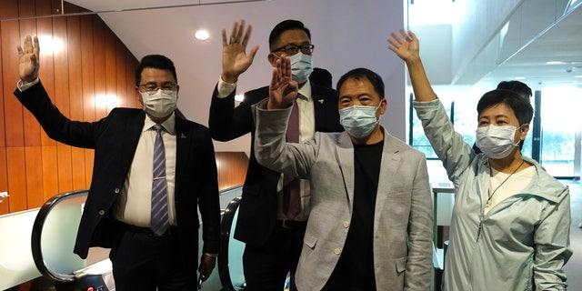 Pro-democracy legislators, from right, Wong Pik Wan, Wu Chi Wai, Lam Cheuk-ting and Yoon Siu Kin wave after handing in their resignations at Legislative Council in Hong Kong on Thursday, Nov. 12, 2020. (AP Photo/Vincent Yu)