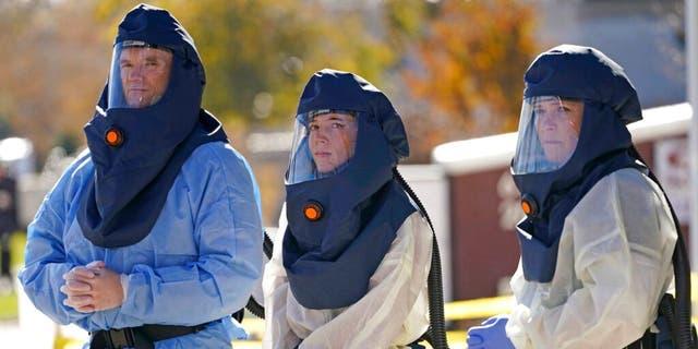 Salt Lake County Health Department public health nurses look on during coronavirus testing outside the Salt Lake County Health Department Thursday. (AP Photo/Rick Bowmer)