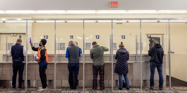 People get tested at the new saliva COVID-19 testing site at the Minneapolis-St. Paul International Airport, Thursday, Nov. 12, 2020.(Elizabeth Flores/Star Tribune via AP)