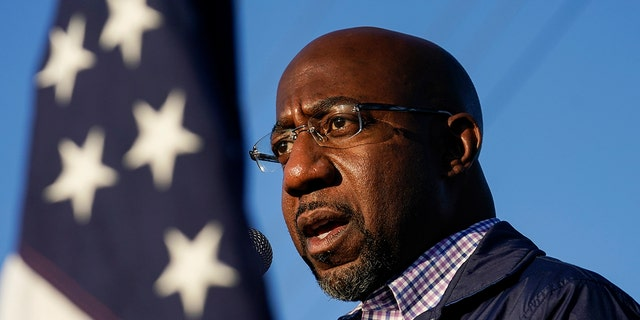Raphael Warnock, a Democratic candidate for the U.S. Senate, speaks during a campaign rally on Nov. 15, 2020, in Marietta, Ga. (AP Photo/Brynn Anderson)