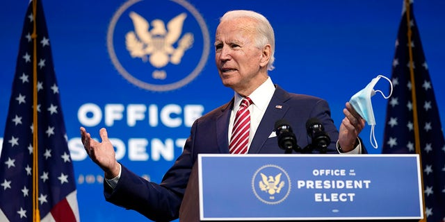 President-elect Joe Biden, accompanied by Vice President-elect Kamala Harris, speaks about economic recovery at The Queen theater, Monday, Nov. 16, 2020, in Wilmington, Del. (AP Photo/Andrew Harnik)