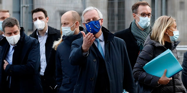 "In this file photo dated Thursday, Nov. 12, 2020, European Commission's Head of Task Force for Relations with the United Kingdom Michel Barnier, centre, leaves the Conference Centre in London with unidentified members of his team. The Brexit trade negotiations have been suspended Thursday Nov. 19, 2020, at a crucial stage because an EU negotiator has tested positive for the coronavirus and EU chief negotiator Michel Barnier said that ""we have decided to suspend the negotiations at our level for a short period."" (AP Photo/Frank Augstein, FILE)"
